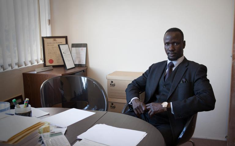 Deng sitting in his office.