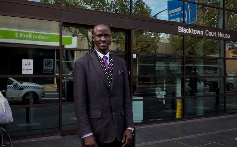 Deng standing in front of Blacktown Court House.