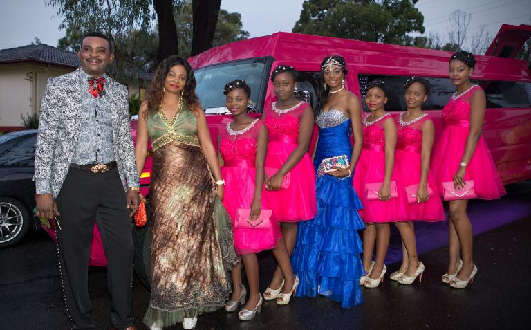Justine and Isaac with their daughter and their daughter's friends, made up for the Sweet 16th party.