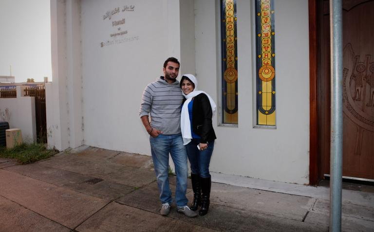Rim and her husband in front of the Mandaean church in Liverpool.