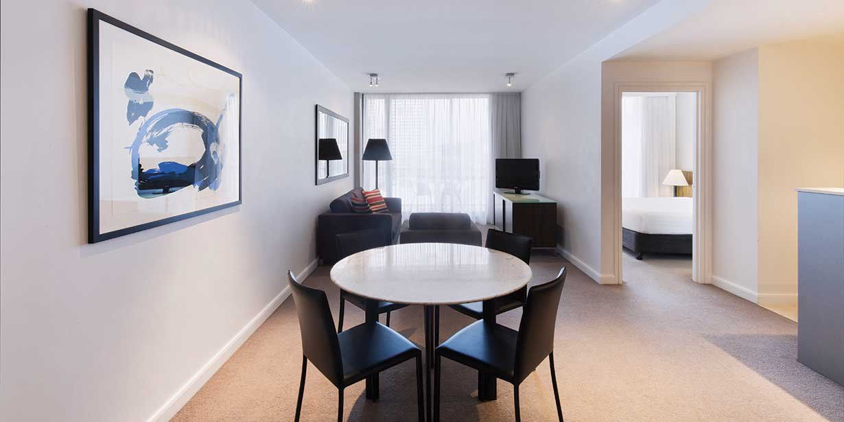 adina-apartment-hotel-sydney-darling-harbour-premier-one-bedroom-apartment-king-lounge-room-and-dining-2016.jpg