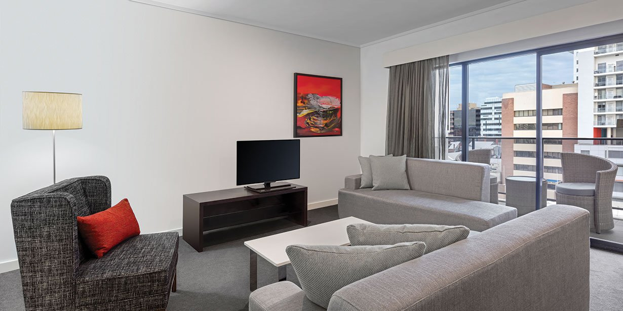 adina-apartment-hotel-perth-barrack-plaza-premier-grand-two-bedroom-apartment-lounge-room-01-2016.jpg