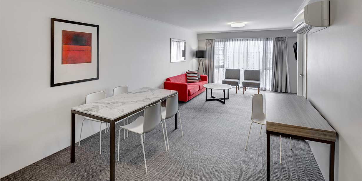 medina-serviced-apartments-canberra-james-court-two-bedroom-apartment-dinning-and-lounge-2016.jpg
