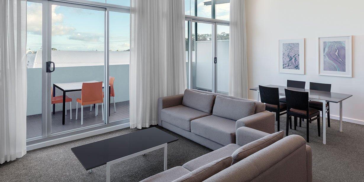 adina-apartment-hotel-perth-premier-grand-one-bedroom-apartment-lounge-room-2017.jpg