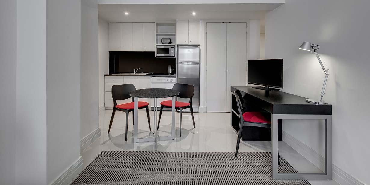 adina-apartment-hotel-south-yarra-melbourne-studio-apartment-dining-kitchen-2016.jpg