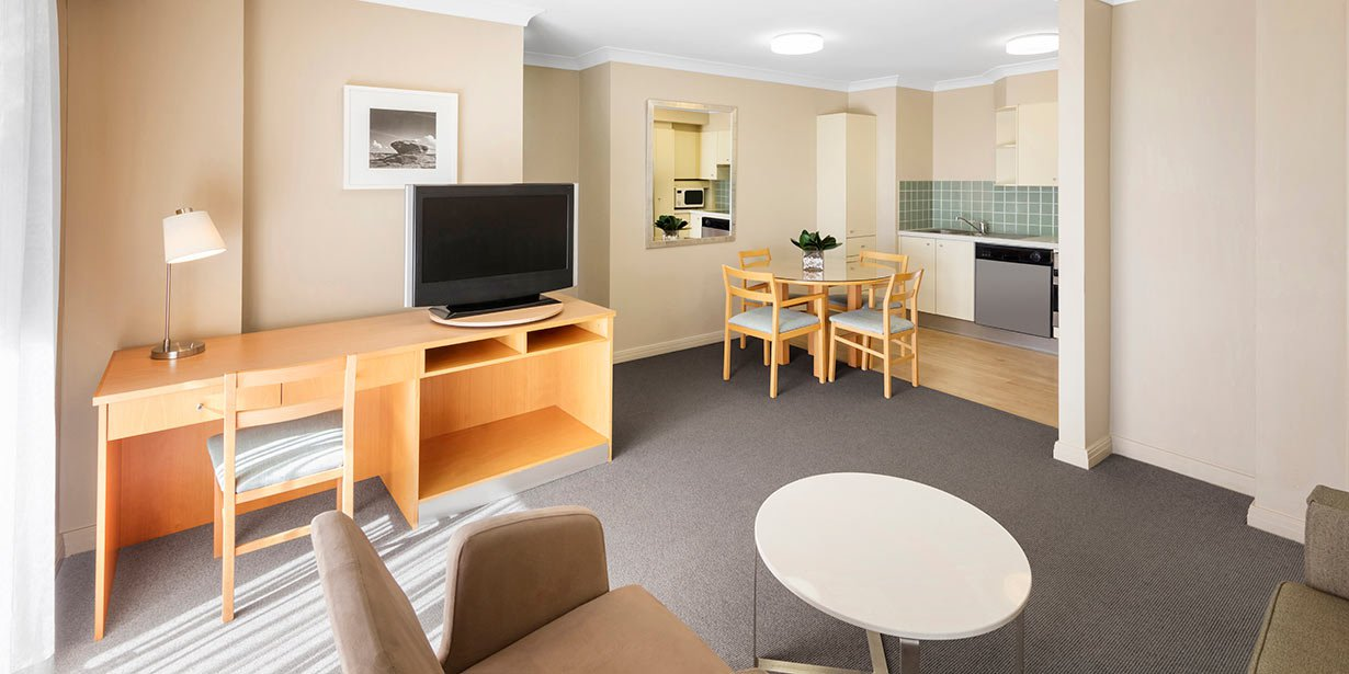adina-apartment-hotel-coogee-one-bedroom-apartment-lounge-room-2016.jpg