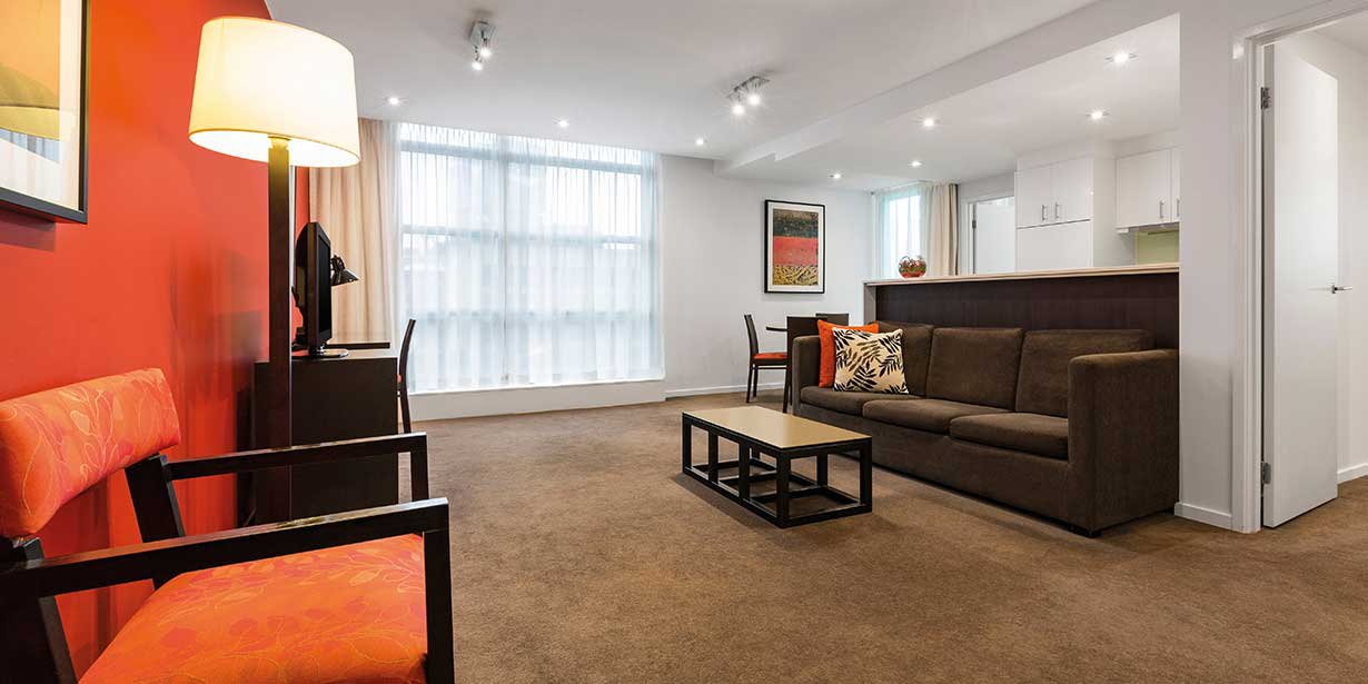 adina-apartment-hotel-melbourne-northbank-two-bedroom-lounge-room-2016.jpg