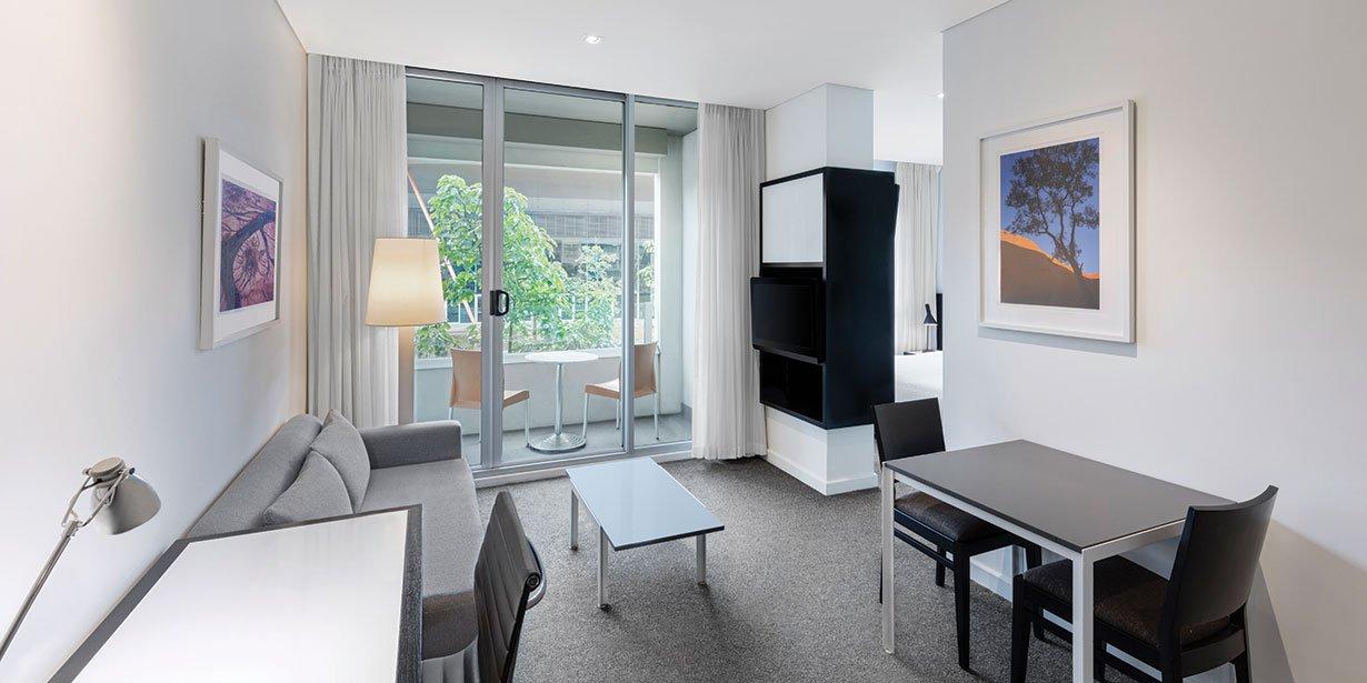adina-apartment-hotel-perth-premier-one-bedroom-apartment-lounge-room-01-2017.jpg