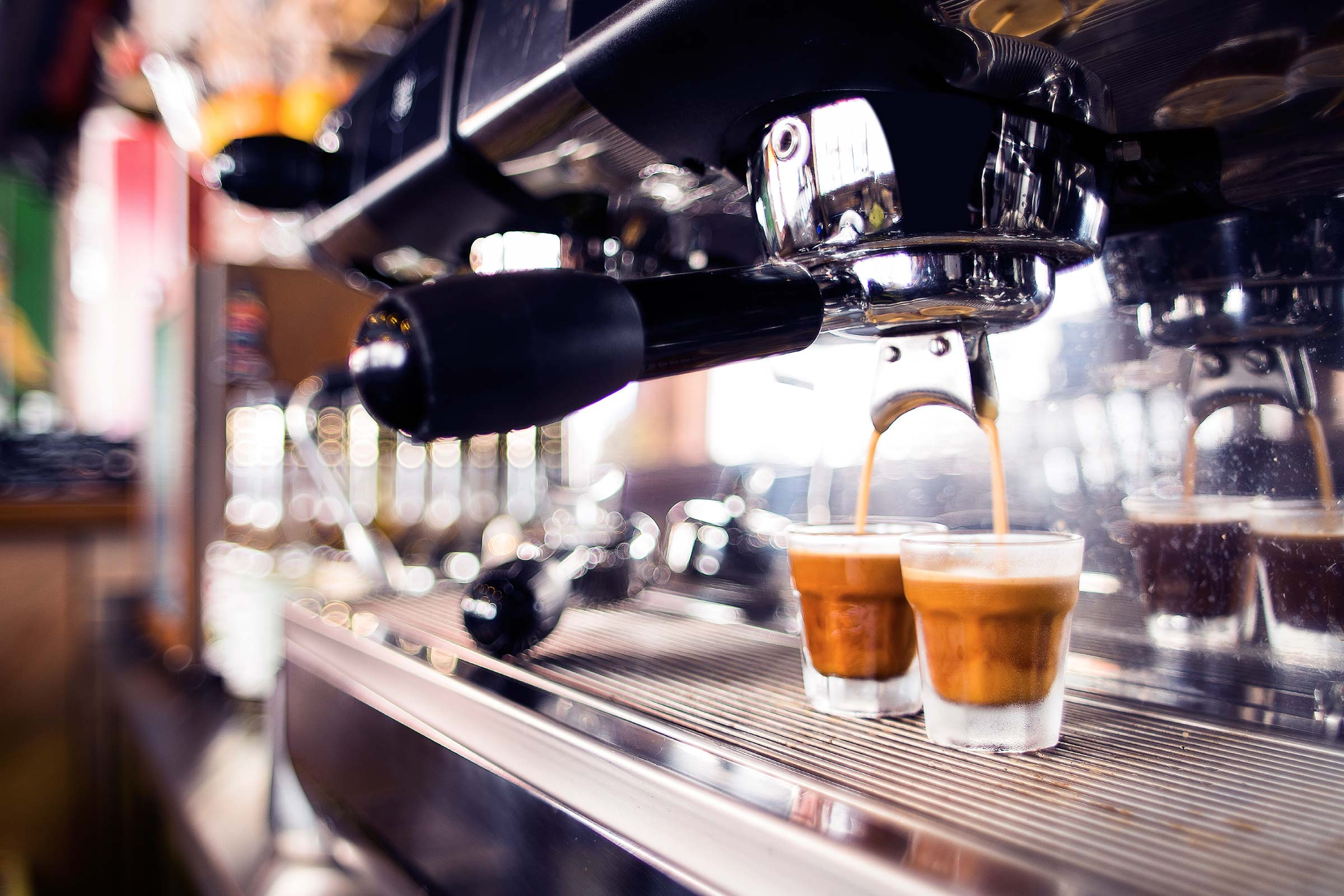 Cafe coffee machine in action making espresso. Penalty rates for Sunday workers have been upheld by the Federal Court.