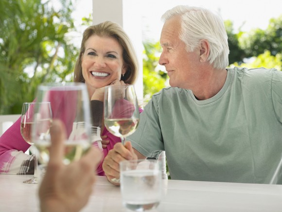 Baby boomers drinking wine and having a good time