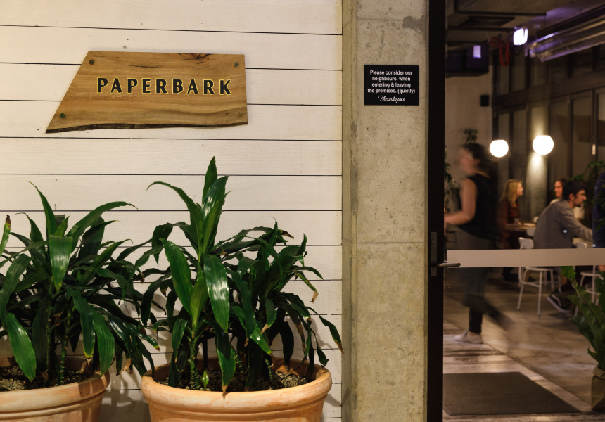 Restaurant entrance with sign reading Paperbark